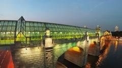 Illuminated bridge Pushkinsky over river with vessels Stock Footage