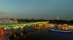 Vessels sail under pedestrians bridge Pushkinsky at summer Stock Footage