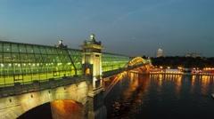 Illuminated bridge Pushkinsky with glass roof at summer Stock Footage