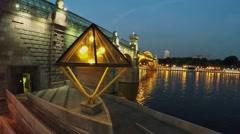 Quay with rhomb shape lantern near pedestrians bridge Stock Footage