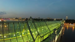 People walk by Pushkinsky bridge with glass roof at summer Stock Footage