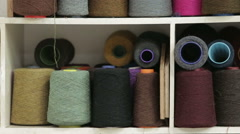 Spools of yarn sitting on a shelf ready to be made into Harris Tweed Stock Footage