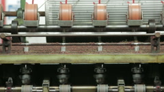 Wool being spun into yarn in a Harris Tweed mill on the Isle of Harris Stock Footage