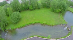 Country houses with grass yards at summer cloudy day. Aerial view Stock Footage