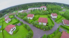 Cottage settlement near forest at summer cloudy day. Aerial view Stock Footage