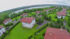 Coastal village with small river at summer rainy day. Aerial view Stock Footage