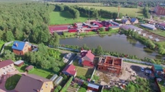 Small pond of fish farm near forest at summer sunny day. Stock Footage