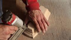 Carpenter joins woodwork nails - stock footage