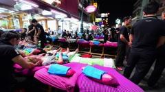 Street massage in Khao San road in BKK city Stock Footage