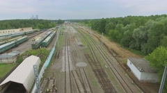 Several money collection trains near railroad at summer Stock Footage
