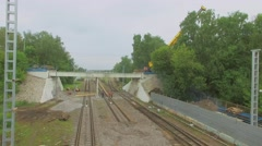 People work on construction site of viaduct and MKZD railway tracks Stock Footage