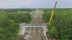 People work on building site of Bogorodsky viaduct and railway tracks Stock Footage