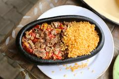 skillet meat with rice - stock photo