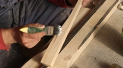 Carpenter gluing wooden parts for furniture Stock Footage