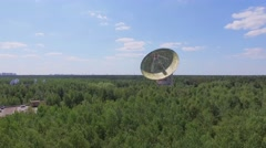 Radio telescope RT-64 Bear Lakes with antenna TNA 1500 among plants - stock footage