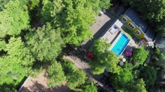 Pool among plants in park at summer sunny day. Aerial view Stock Footage