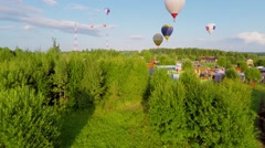 Air Balloons fly above fields at summer day in Pereslavl Zalessky Stock Footage