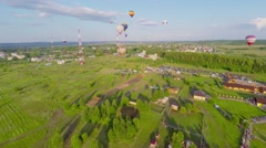 Landscape with several air balloons fly above fields at summer Stock Footage