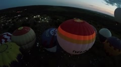 Air balloons start fly from field with many people at summer Stock Footage