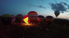 Several air balloons begin fly from field with many people Stock Footage