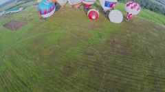 Grass field with several air balloons before fly at summer Stock Footage