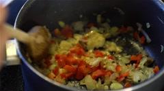 Cooking vegan food in pan Stock Footage