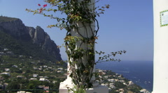 Capri scene vista from building on hill rock and buildings Stock Footage