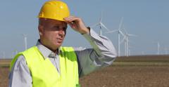 Worker Drink Water Thirsty Engineer Hot Summer Day Wind Turbines Farm Tired Man - stock footage