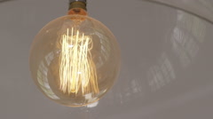 Incandescent light bulb glowing with energy and light - stock footage