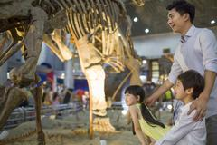 Stock Photo of Young father and children in museum of natural history