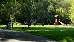 View of the children playground in the nature surrounded by forest and high rock Stock Footage