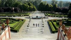View of the square and garden before chateau Troja - people walk  Stock Footage