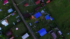 Cottages settlement at summer evening. Aerial view Stock Footage