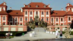 View of the fountain with statuary -sidewalk to entrance of chateau Troja Stock Footage