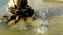 Detail of the fountain in the garden - water fall into the pool - sunny day Stock Footage