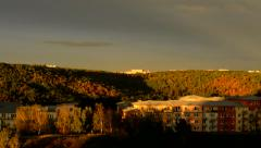 View of prefab housing estate in the suburb surrounded by large forest  Stock Footage