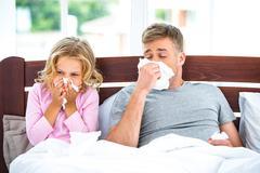 Young family having flue or allergy Stock Photos