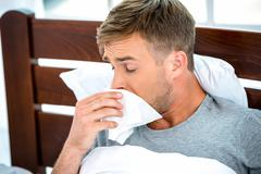 Young man having flue or allergy Stock Photos