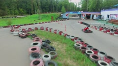 Racing track with carts at summer cloudy day. Aerial view Stock Footage