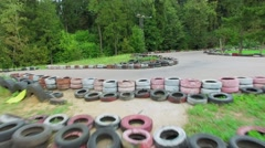 Racing track with many tyres on sides at summer cloudy day Stock Footage