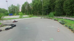 Two sportsmen drive on carts at summer cloudy day. Stock Footage