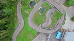 Racing track with several carts at summer day. Aerial view Stock Footage
