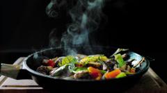Cooked meat meal with vegetables in a pan Stock Footage