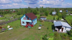 Cottages settlement at summer sunny day. Aerial view Stock Footage