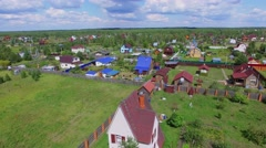 Small village near forest at summer sunny day. Aerial view Stock Footage