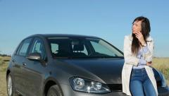 view of the young contemplative attractive woman stands by the car - stock footage