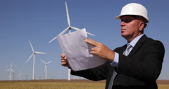 Stock Video Footage of Businessman Examine Renewable Alternative Energy Sheets Wind Turbines Developer