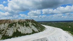 Road on White Mountain with phosphogypsum open-cast mine Stock Footage