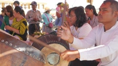 Drum being played and praying at Dorngkeur Shrine,Phnom Penh,Cambodia Stock Footage