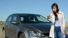 Young attractive strict woman disagrees - gesture - car Stock Footage